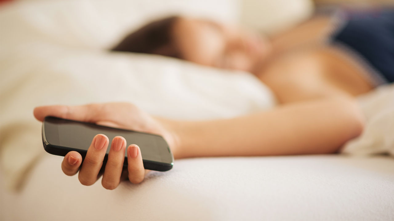 woman-sleeping-with-cell-phone